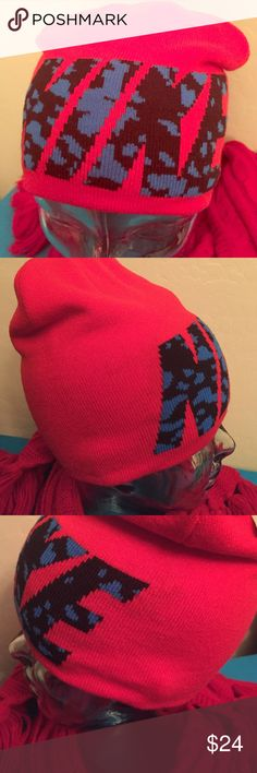 Nike Beanie Authentic Nike Beanie. Unisex. One Size. Bright Red with Blue & Black Animal Print Nike Graphics on the Front. Blue Embroidered Nike Swoosh on the Back. Ribbed Knit. 100% Acrylic. Brand New. Excellent Condition. No Trades. Nike Accessories Hats