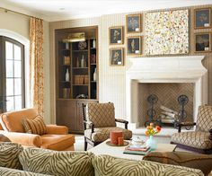 A sprinkling of orange accents injects energy into this otherwise-neutral living room. An accent wall of striped white-and-beige wallpaper gently draws the eye toward the dramatic fireplace and mantel display. Old Fireplace, Fireplace Design, Fireplaces, Mantle, Fireplace Ideas, My Living Room, Home And Living, Living Spaces, Cottage Living