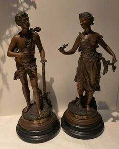 """<p dir=""""ltr"""" style=""""margin-top:0; margin-bottom:0;"""">Antique Ernest Rancoulet Pair Of Large Spelter Figures of Poete & Muse mounted on wooden bases.</p> <br> <p dir=""""ltr"""" style=""""margin-top:0; margin-bottom:0;"""">Muse seems to have lost her fingertips on one hand as shown in photos and both have some rubbing to the colour and surface marks giving them a nice old patina.</p> <br> <p dir=""""ltr"""" style=""""margin-top:0; margin-bottom:0;"""">Measuring 39cm tall</p> <br> <p dir=""""ltr"""" style=""""margin-top:0…"""