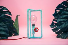Designer table lamp in joyful colors - turquoise patina metal finish, red dimmable knob and red braided cord. A very decorative idea for bedside lamp to downtown loft and artistic feel apartment. Manufactured by European design studio. Available in Zapalgo online store.
