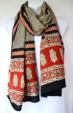 Red and Black Striped Tribal Scarf  Hand block by MaeluDesigns, $34.50, http://www.etsy.com/listing/110757607/red-and-black-striped-tribal-scarf-hand?ref=sr_gallery_42_includes%5B0%5D=tags_search_query=eco+friendly+scarf_page=2_search_type=all_view_type=gallery  100% cotton, it is made with natural vegetable dyes.