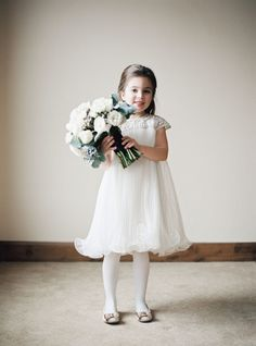 Elegant flower girl in Marchesa. Photography: Brumley And Wells - brumleyandwells.com