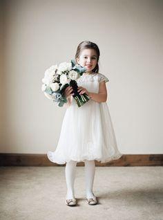 Elegant flower girl in Marchesa. Photography: Brumley And Wells - brumleyandwells.com