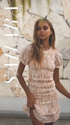Shirred mini dress in neutral tone print. Features puff sleeves, ruffle hem and zip back. #minidresscasual #neutral #shirred #winonaustralia Neutral Palette, Puff Sleeves, Textile Prints, No Frills, Best Sellers, Hemline, Short Dresses, White Dress, Zip