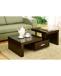 The different levels of this coffee table make it an eye-catching piece. Get it here: http://www.bhg.com/shop/enitial-lab-kyle-modern-coffee-table-p5006ce5682a797dc893f8ead.html