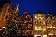 Bernkastel-Kues Christmas Market - Write your wishes in Das goldene Wunschbuch!  Bernkastel-Kues is located on the Moselle River between Koblenz and Trier. There you will find a romantic little town with half-timbered building and a church more than 600 years old, St. Michael's Church.  Beautiful, Gorgeous wine country! It seriously feels like you stepped out of the pages of a storybook.   germanyja.com