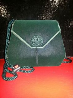 This is my own personal vintage green velvet cross over bag I got at a vintage store at North Loop, ATX.