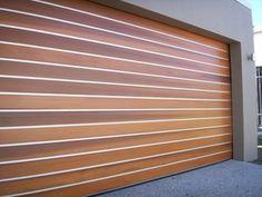 @avivbeber3 Modern Garage Doors- clear anodised strips between western red cedar