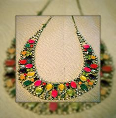 my weekend craft project - cheapy rhinestone necklace painted with various colors of nail polish