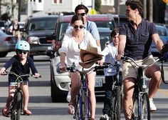 """Enjoying her sunny Saturday, Hilary Swank cycled down Abbot Kinny with boyfriend Laurent Fleury and his two children after lunch at Gjelina's in Venice Beach (March 2).    The """"Million Dollar Baby"""" star looked breezy in a white top, shorts, and a straw-colored hat as she pedaled next to her beau."""
