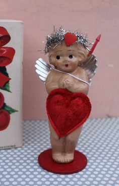 DARLING. This plaster vintage boy just needed a new look and Cupid seemed like just the right thing! He now sports little silver wings, a quiver