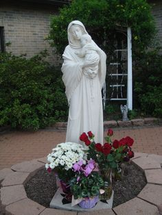 The Virgin Mary in the garden at St. Justin Martyr Church in Houston, TX.  Love this, but I'd put an icon shrine instead of a statue.