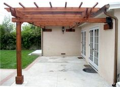 pictures of pergolas attached to house | 24-Foot Pergola with Custom Hybrid Attachment Method