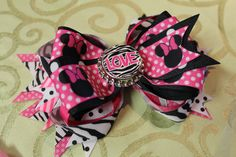 """Over the top bow in """"MM LOVE"""" visit www.facebook.com/MandMinthemirror or  contact me directly Jodig1223@aol.com"""