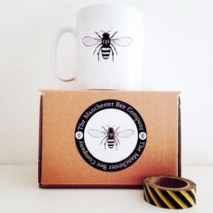 White mug featuring the iconic Manchester Worker Bee that has been the emblem of the great city of Manchester UK since the Industrial Revolution.Original Manchester Bee illustration on one side in blackDescriptive text on one side in black11 fl oz ceramic mug Dishwasher   Microwave safeMeasures 90mm tall   110mm wide inc handle   80mm circumferenceShipped in protective giftbox