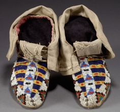 A PAIR OF SIOUX BEADED HIDE MOCCASINS