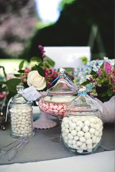Cute Idea: Pink and white candy like Jordan almonds and marshmallows in antique clear glass and pink milk glass jars