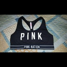 VS PINK Sports Bra Sports bra that says PINK on the front. PINK NATION on the bottom. Price tag is off but never worn. PINK Victoria's Secret Intimates & Sleepwear Bras
