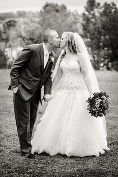 DeMuth-Eggleston Wedding Photo By Visions by Heather Bride and groom kiss. Allure 8901