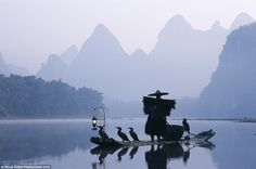 The cormorant fishermen on the Li River near Guilin, China, often now pose for photos for ...