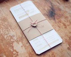 invitation - this shape would fit in a normal envelope, yet seems formal to me. Button and twine is a fun alternative to ribbon.