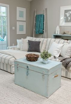 I love the stripped sofa, the ladder is a good place for blankets #shabbychic