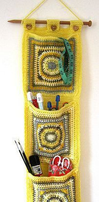 19 Impossibly Clever Knitting And Crochet Patterns - some of these are dumb, but this hanging pocket thing looks cool