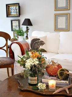So pretty Notice.greenery in back Photo arrangement Pillow Coffee table object placement