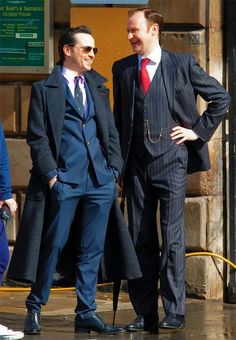 Moriarty and Mycroft being all sassy with his hand on his hip!