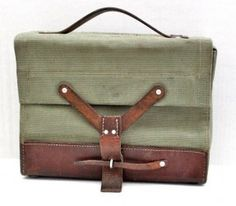 Handbag as sophisticated accessory in Vintage style. It is made of canvas with leather accents. It
