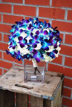 Table center- Tie Dye Dendrobium Orchids  Jen Antoniou Jen Antoniou Weddings and Events www.jenantoniouweddings.com events@jenantoniou.com 707-992-5872
