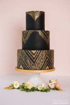 This sleek black and gold cake. | 25 Incredibly Beautiful Wedding Cakes That Won 2015