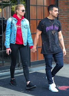Perfect pair: Sophie Turner and boyfriend Joe Jonas ditched the Met Gala glamour as they cut a more relaxed and trendy vibe while leaving the Bowery Hotel in New York on Tuesday