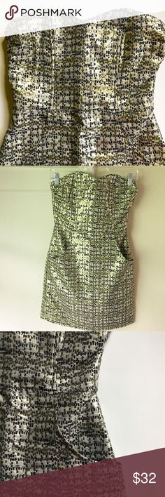 """Shimmery Strapless Dress Shimmery Strapless Dress. Sweetheart neckline. Two pockets! Fully lined. 62% Cotton / 23% Polyester / 15% Metallic Fiber. Dry clean only. Lining 100% Polyester. Back zip 12.5"""" long. Back slit 5"""". Flexible boning around bust/bodice. Length about 26.5"""" from top of neckline to hem. Underarm to underarm about 14"""". Waist about 12.5"""" wide. Hem about 18"""" wide. All measurements when laid flat. In excellent condition. H&M Dresses Strapless"""