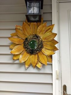 I loved these large metal flowers, but I didn't love the price so I made my own for A LOT less with items from Dollar Tree and Walmart.