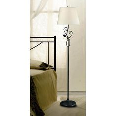 Cast a warm, inviting illumination over any room in your home with this floor lamp. The piece features an elegant leaf-shaped design incorporated into its stand, creating a beautiful appearance. The oil rubbed bronze finish adds to its elegance.