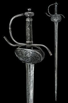 """Espada de conchas. España. Finales del siglo XVIII. Concha decorada con una imagen del dios Marte. Hoja marcada """"SAHAGUM"""". Straight, Long: 100 cm."""