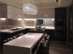 But the real stunner, and treasure of the house, is the chandelier.  The anchor of the room is a double layer Swarovski chandelier custom-ordered by the designer for the hostess The center island showcases an expandable design allowing for entertaining even with limited space.