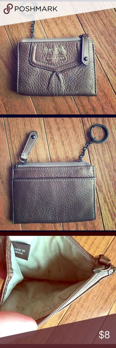 Coach change keychain wallet BRONZE color Bronze coach change wallet comes with key chain. Has marks on inside. 2 small dark spots on front but you can't really tell. Coach Bags Clutches & Wristlets
