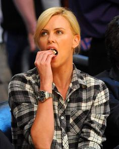 I like my Movados watches but think I'd like to try one of these.. I love that pink one too.    (Charlize Theron at a recent L.A. Laker's game sporting her Rolex DEEP-SEA.)