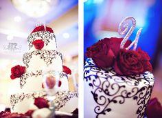 black and white cake, buttercream cake, scrolls, red roses, cake topper, blue lighting, wedding reception