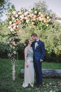floral ceremony arch - photo by Lara Hotz http://ruffledblog.com/a-garden-greenhouse-wedding-in-australia #weddingportrait #weddingphotography