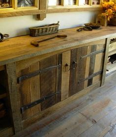 These cabinets were made when a barn was disassembled. The barn siding used on the cabinet doors has a natural, weathered look that can't be replicated with modern finishing methods. Barn door hardware compliments the wood for a unique and authentic look.