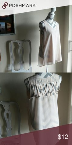 Short sleeve blouse Light and flowy tank in the sheer side with a criss cross open in the back. Tank is longer in back than the front.  100% Polyester, Hand wash Cold October Sky Tops