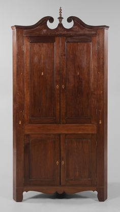 Southern Federal Inlaid Cherry Corner  Cupboard possibly Kentucky, 19th century, trailing vine, line, bellflower and flowerpot inlays, poplar secondary, pegged backboards, 93 x 47 x 22 in.