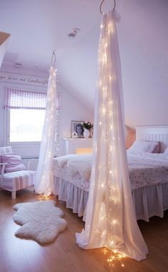 gorgeous bedroom idea ~ I think our 3 girls would love these lights strung between their beds.