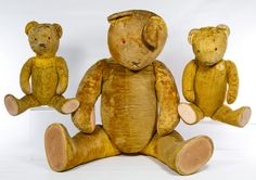 Lot 494: Golden Teddy Bear Assortment; Three unmarked bears with cloth pads; largest has excelsior stuffing, velvet plush and plastic eyes; smaller ones have mohair plush and glass eyes