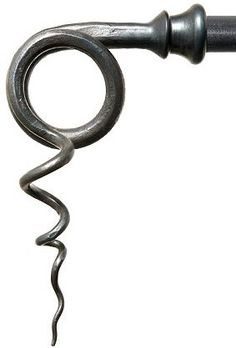 Handforged wrought iron tendril curtain pole finial