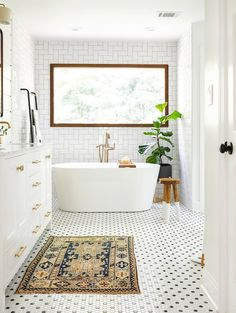 White Bathroom Ideas - Prior to you begin enhancing an all-white bathroom, there are a few points you require to know. A skilled shares her necessary white bathroom . Small Bathroom Tiles, Bathroom Tile Designs, Bathroom Design Small, Bathroom Interior Design, Bathroom Ideas, Master Bathroom, White Bathrooms, Bathroom Mirrors, Bathrooms With Plants