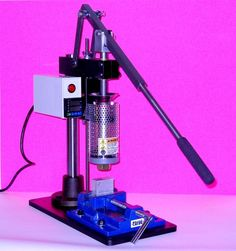 Picture of My bench model plastic injection molding machine.